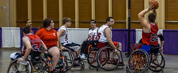 Adaptive athletes compete in a game of wheelchair basketball.