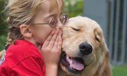 Bringing a Service Dog into your life.  Photo of girl with service canine.