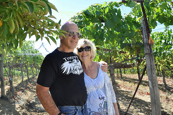 Chris Rohan with her husband at vineyard.