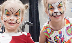 Face Painting: Two Girls at Abilities Expo