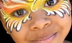 Face Painting: Image of Smiling Child with Intricate Butterfly pattern.