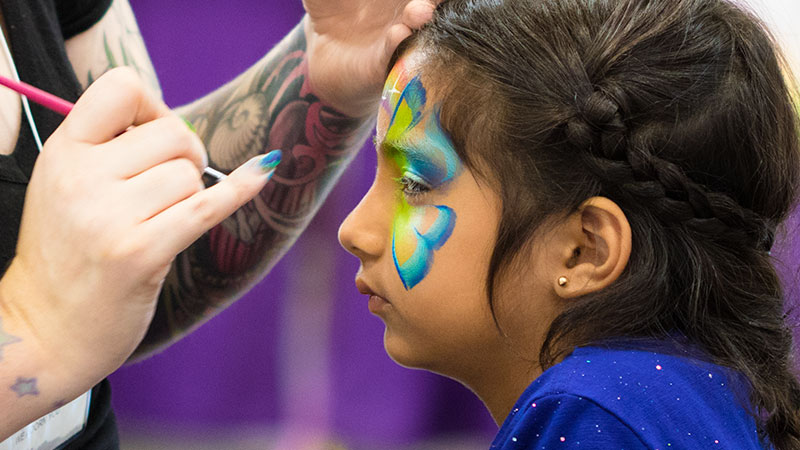 Facepainting at the Abilities Expo