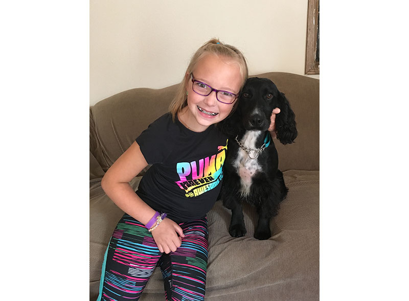 Girl and her service dog