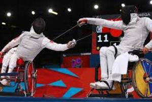 Wheelchair Fencing demonstration.  Two fencers compete.