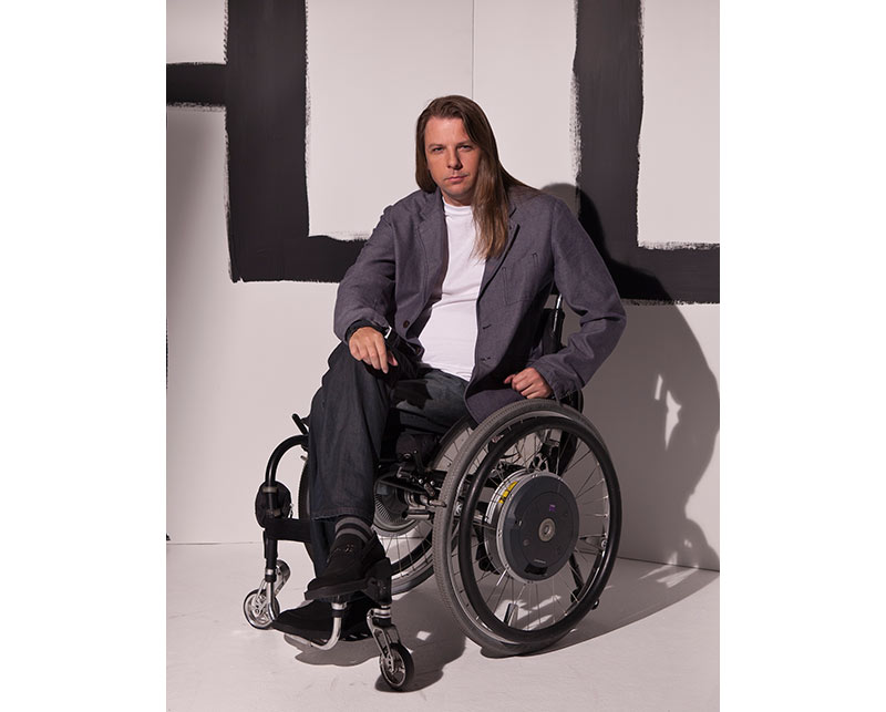 Man in Wheelchair sporting adaptive clothing