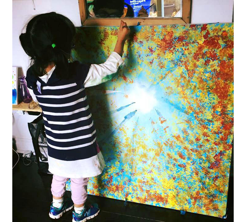 Ilona, painting a massive and beautiful picture