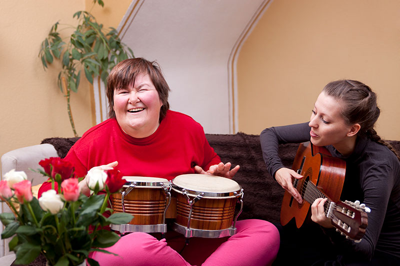 Music Therapy for Autism. Photo of adult woman with headphones.