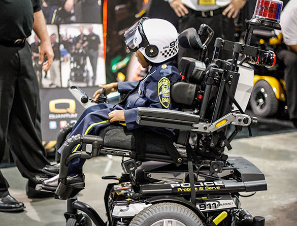 Police Officer Morgan in his Q6 Edge Power Chair from Quantum Rehab