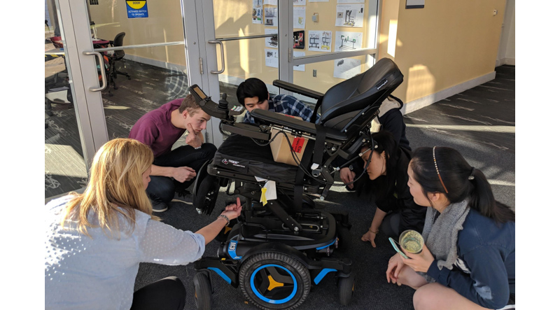Students working with power wheelchair technology