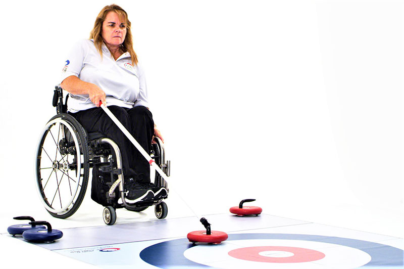 Lady in Wheelchair playing FloorCurl